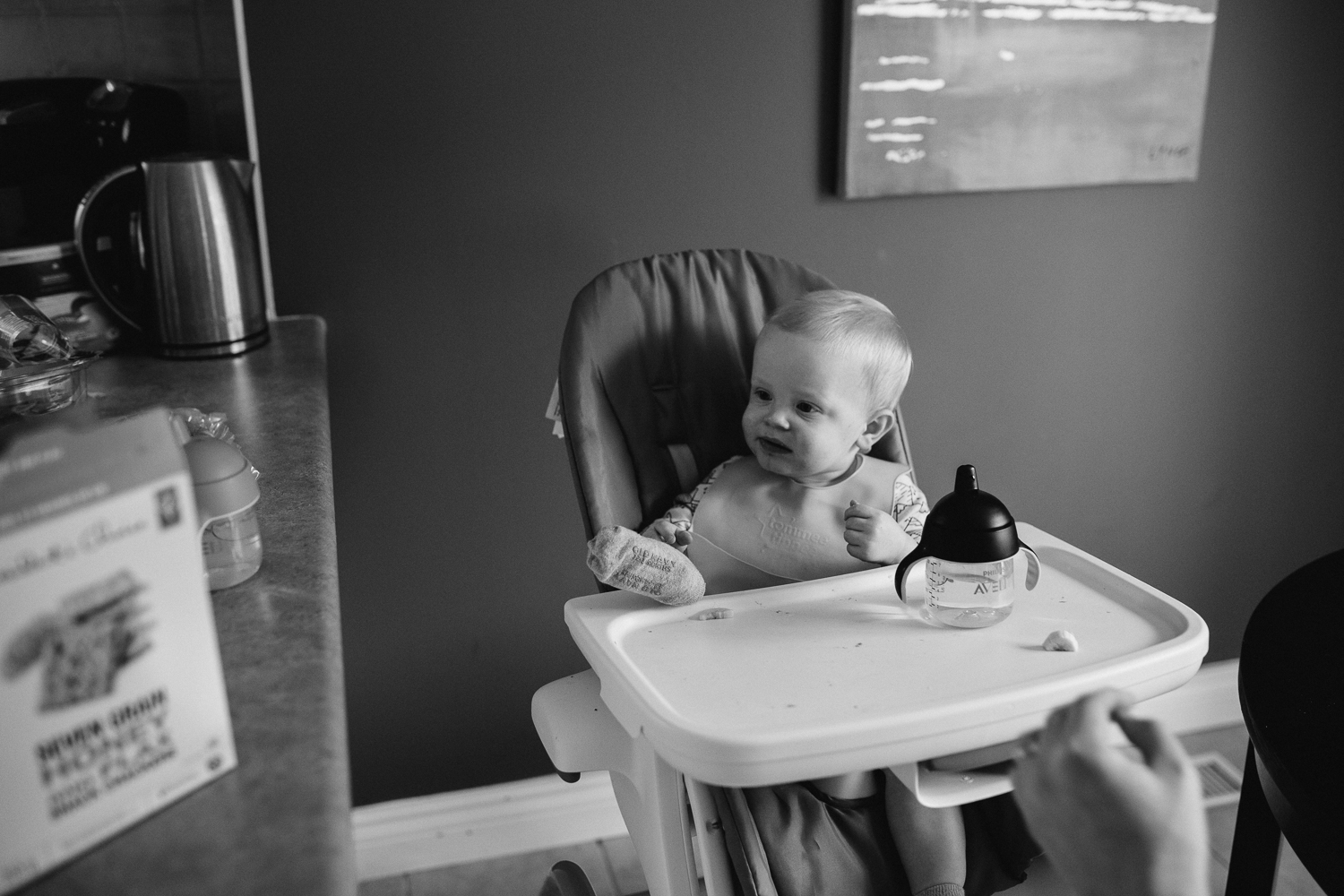 1 year old baby boy in high chair with foot on tray - Newmarket lifestyle photography