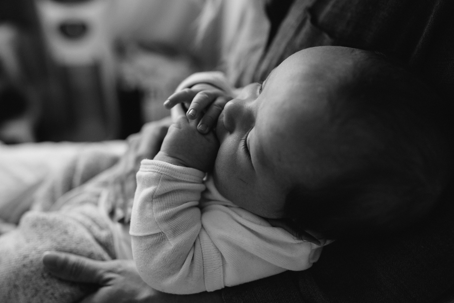 2 month old baby boy in mom's arms {Toronto Family Photographer}