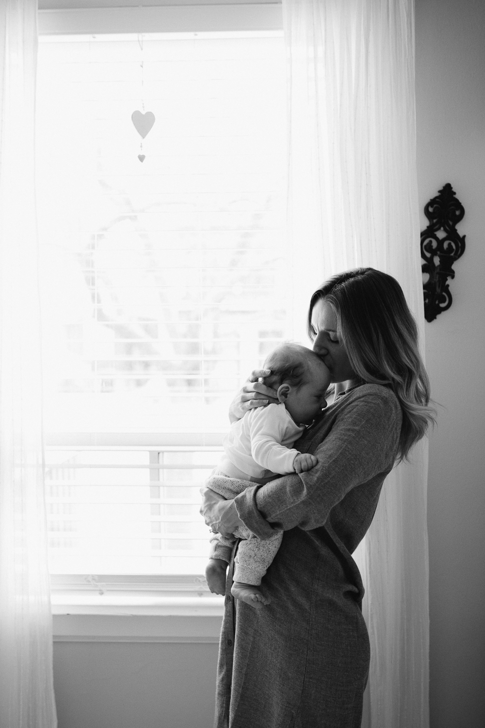 Mom kissing 2 month old baby boy {Toronto Family Photographer}