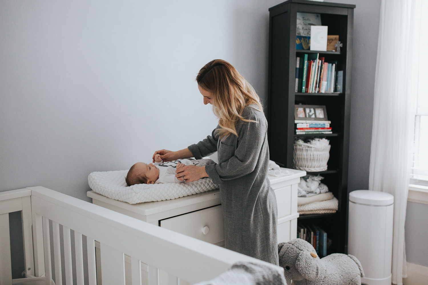 2 month old baby boy on changing table with mom {Toronto Family Photographer}