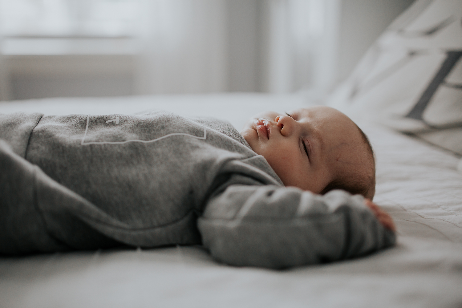 2 month old baby boy lying on bed {Toronto Family Photographer}