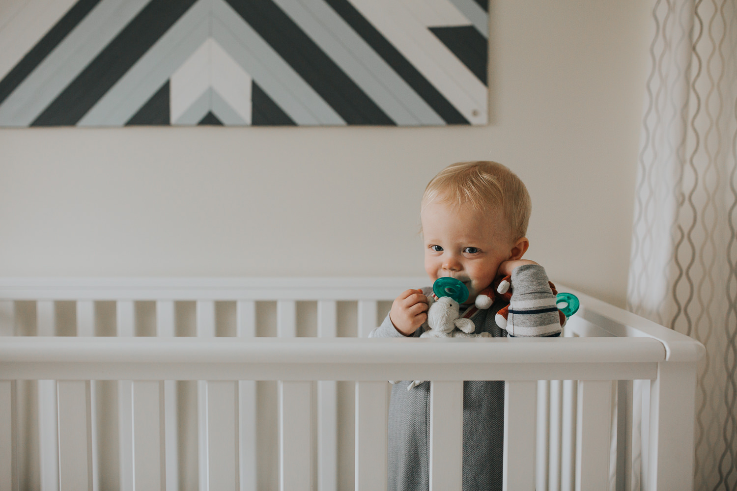 1 year old toddler boy in crib with soother - Uxbridge baby photos
