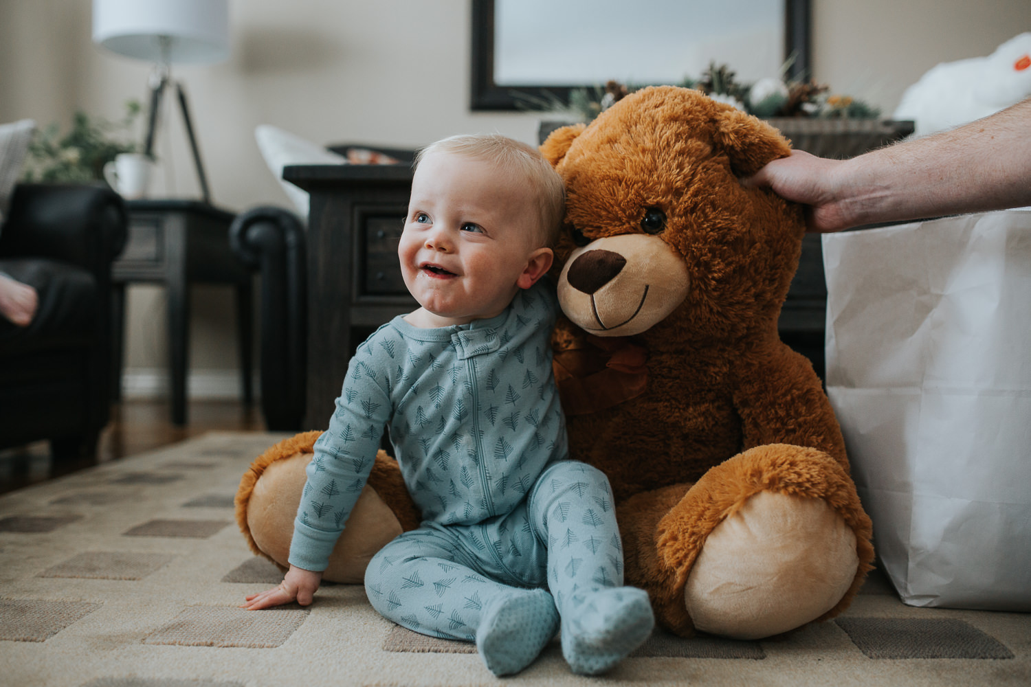 1 year old baby boy with giant stuffed bear on christmas morning - stouffville child photography
