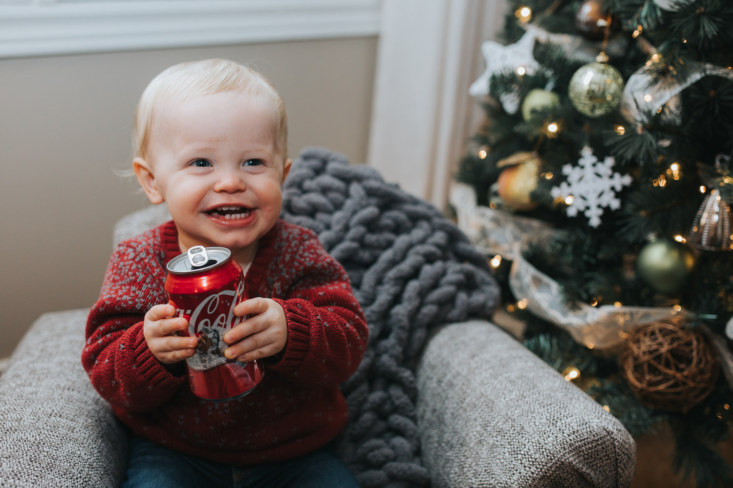 1 year old toddler boy with can of coca cola beside christmas tree - markham child photos