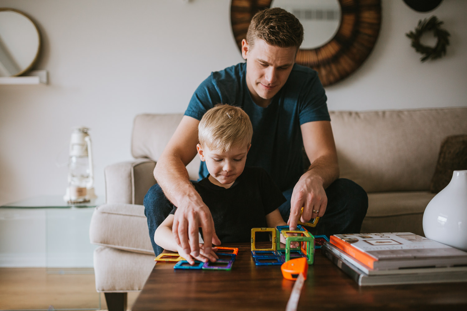 father and son playing in living room - Uxbridge family photos