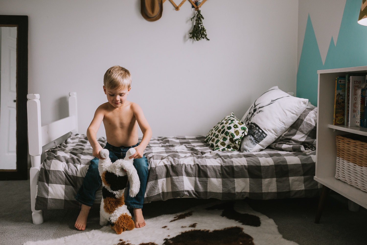 5 year old blonde boy playing with stuffed animal in bedroom - Uxbridge family photography