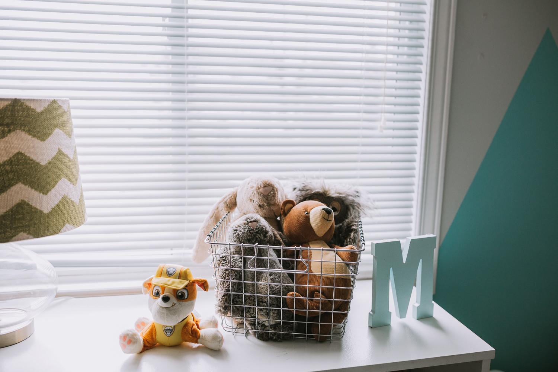basket of stuffed animals in basket on bedroom dresser - newmarket lifestyle photos