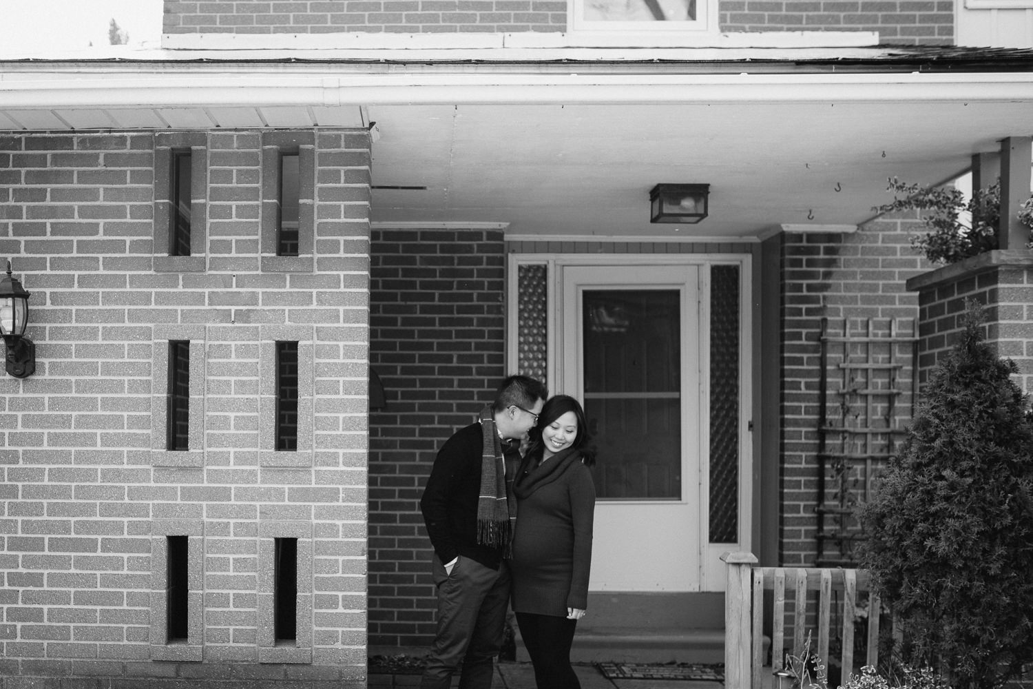 couple expecting first baby in front of first home - Markham lifestyle photography