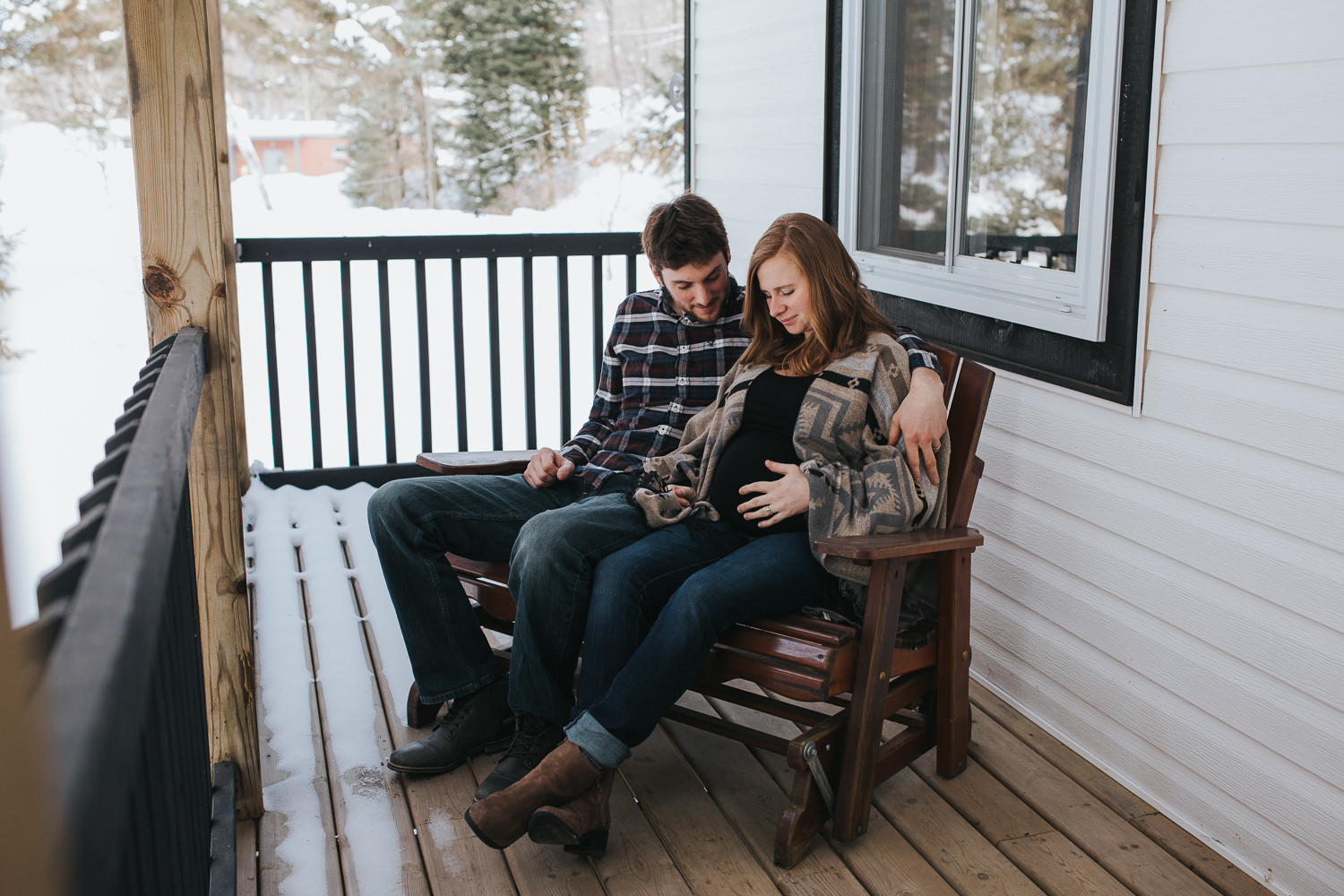 parents to be sitting on front porch looking at wife's baby bump - Newmarket lifestyle photography