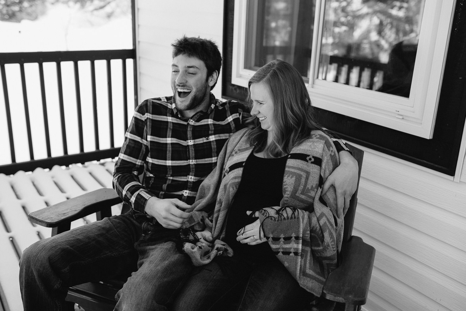 parents to be sitting on front porch laughing together - Stouffville lifestyle photography