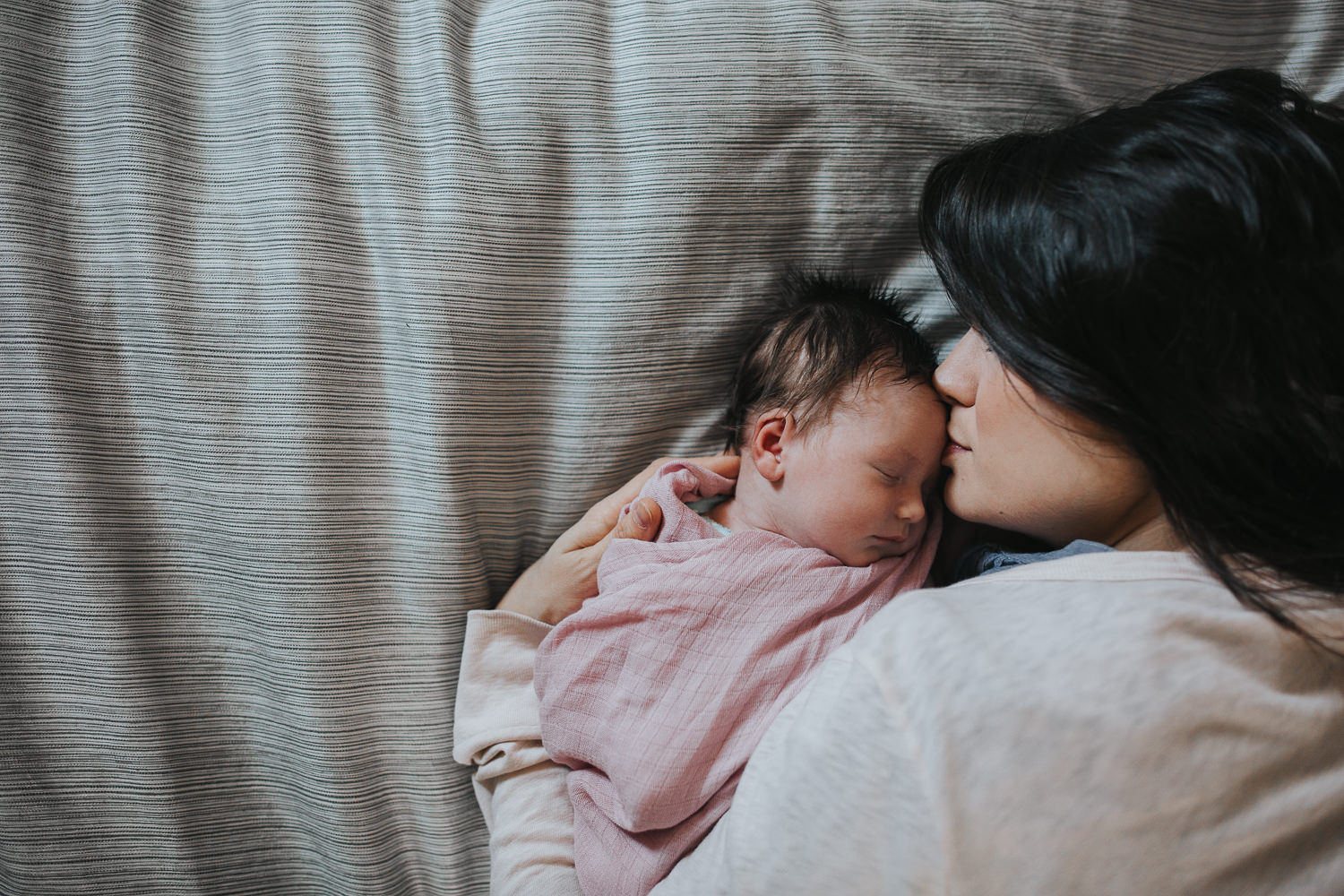 new mom snuggled face to face with 2 week old baby daughter - Barrie lifestyle photography
