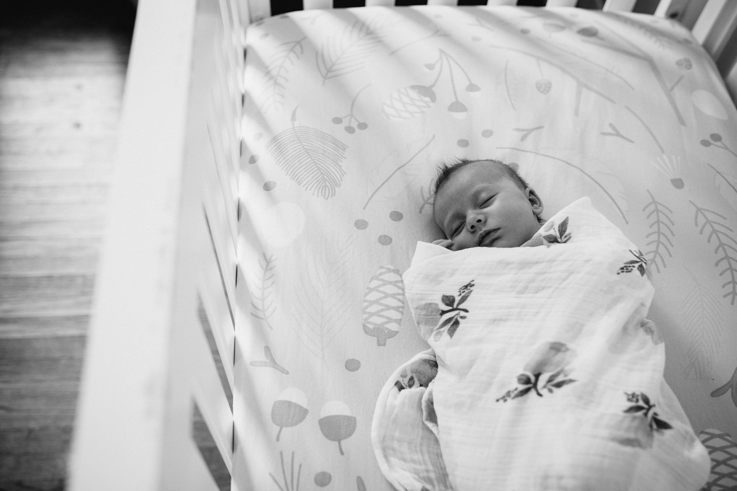 5 week old baby girl swaddled and sleeping in crib - Newmarket lifestyle photos
