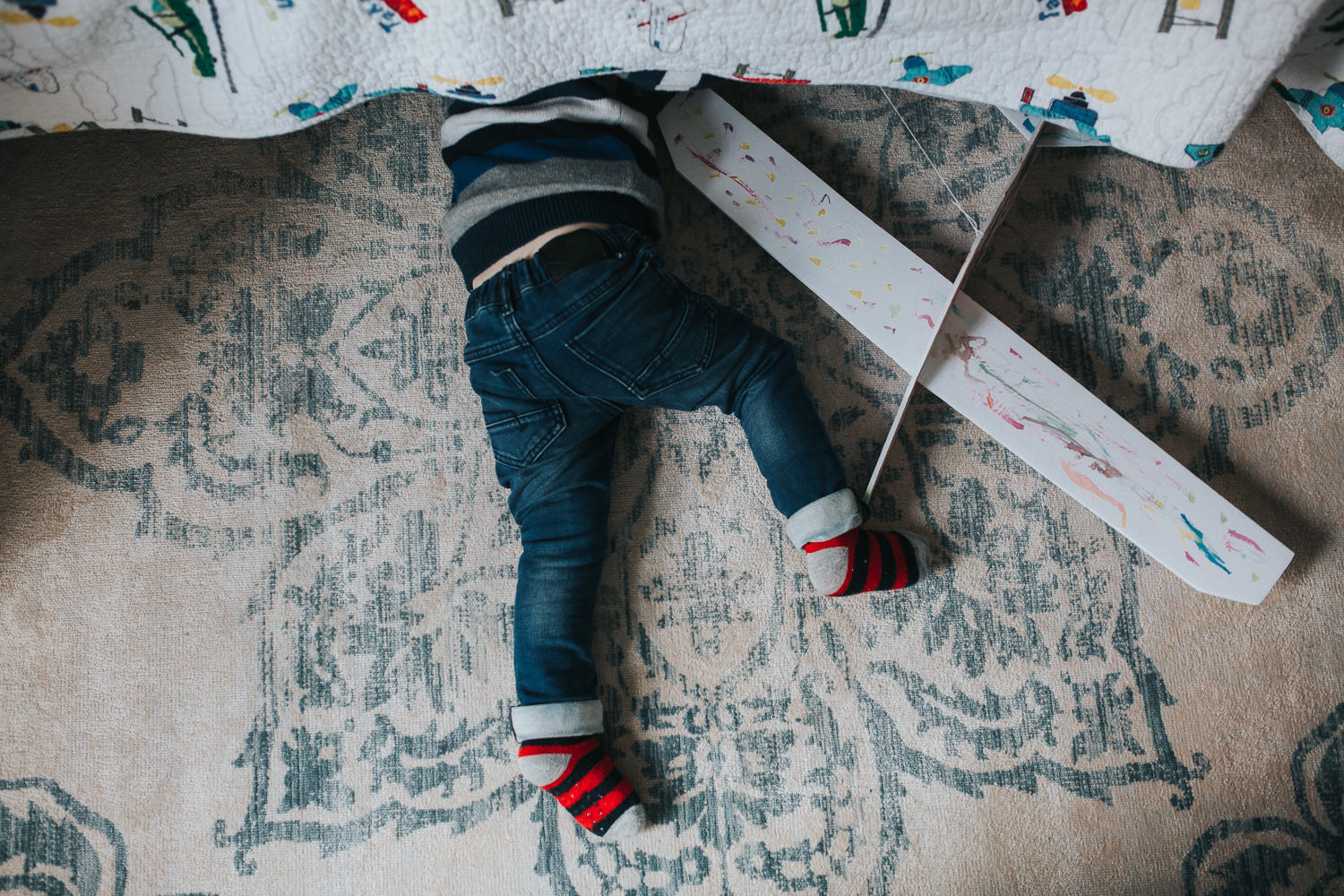 3 year old toddler boy with head under bed looking for toy - Newmarket lifestyle photography