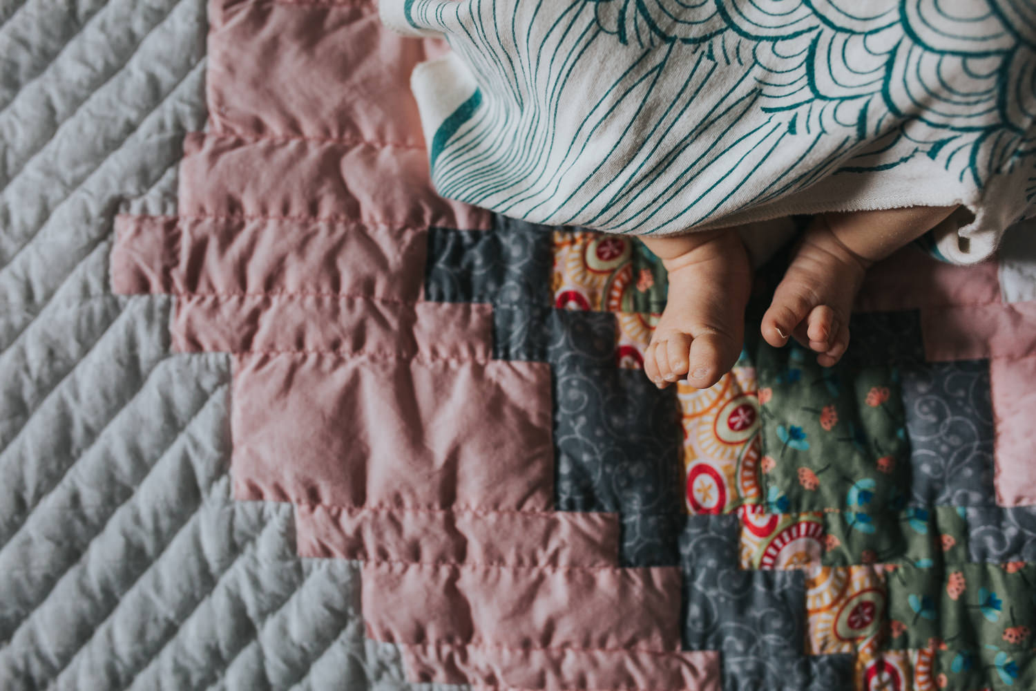 close-up of baby girl feet lying on handmade quilt - Stouffville lifestyle photos