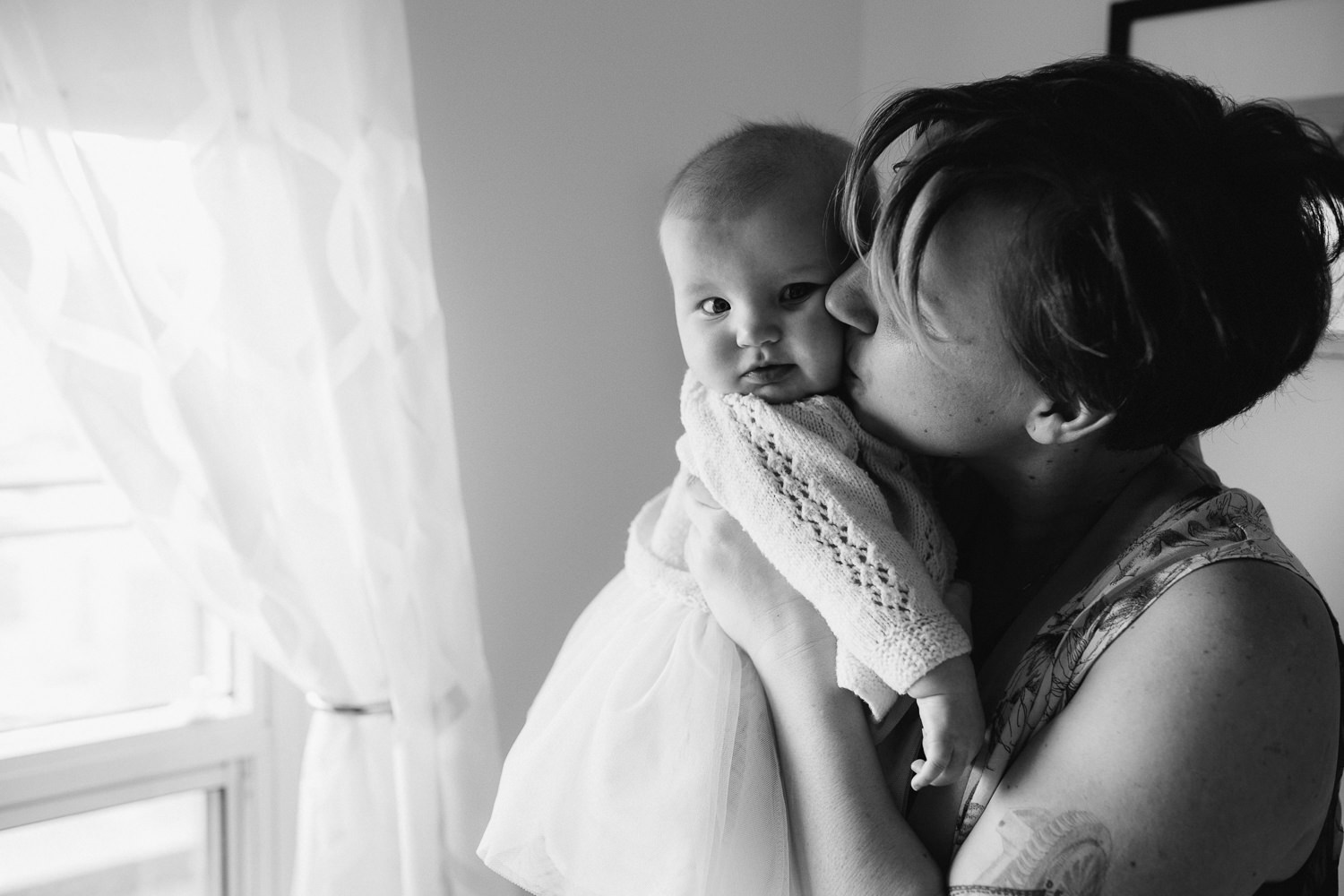 mom kisses 5 month old baby girl on cheek - Markham lifestyle photos