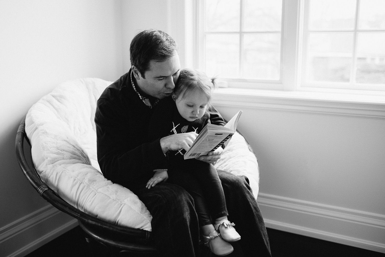 2 year old toddler girl sitting in dad's lap reading story book - Newmarket lifestyle photos