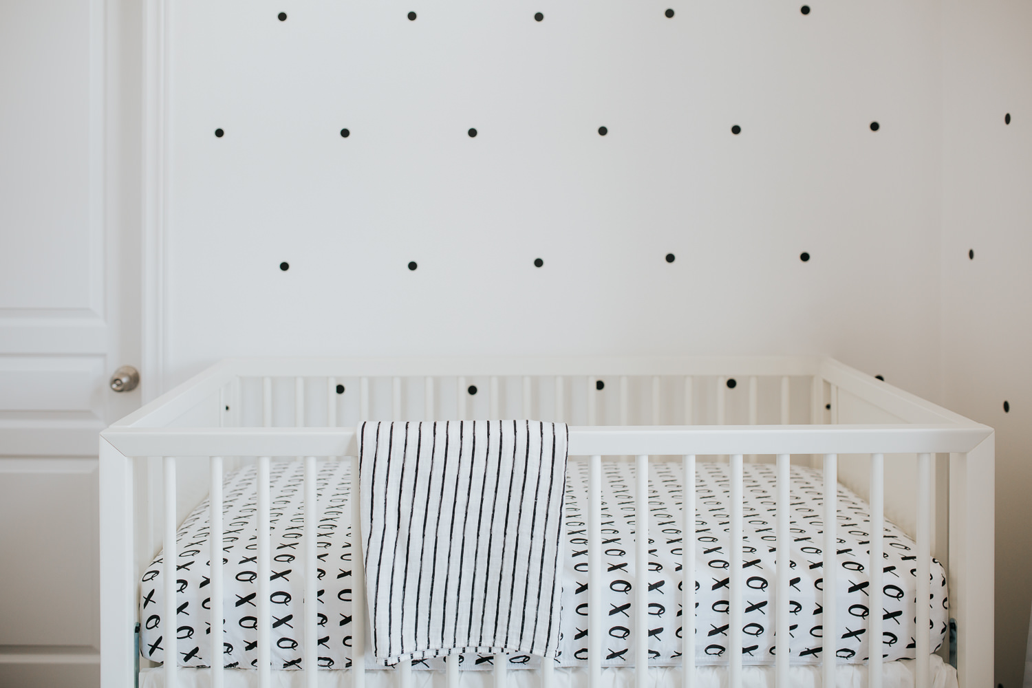 black and white nursery details, white crib and polka dot decals - Stouffville lifestyle photos