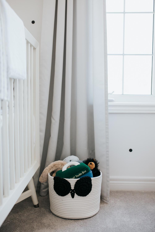 monochromatic black and white nursery details, basket of stuffed toys - Uxbridge lifestyle photos