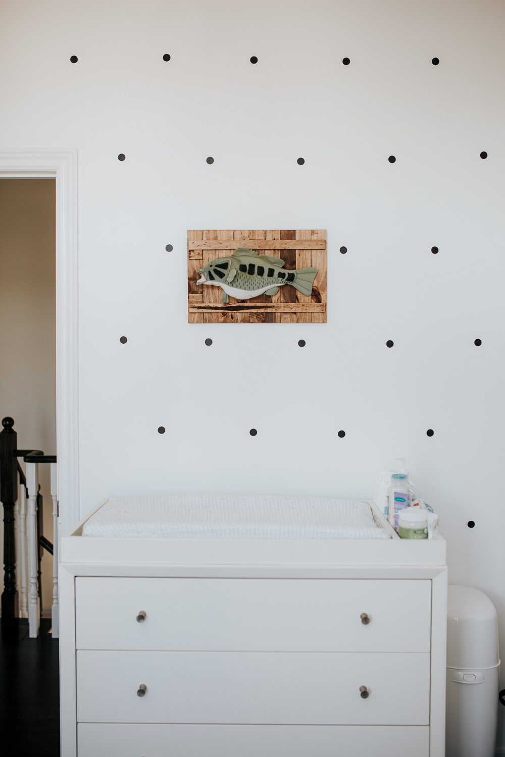 monochromatic nursery details, white change table and polka dot wall decals - Markham lifestyle photos