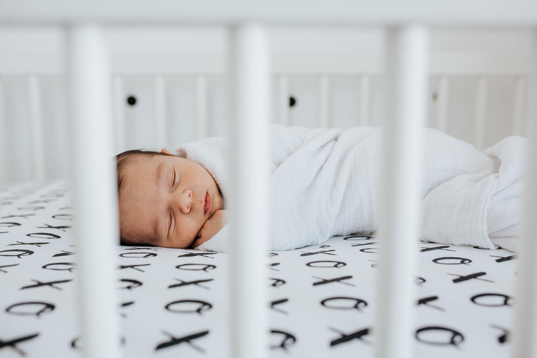 2 week old baby boy sleeping in monochromatic black and white nursery crib - Markham lifestyle photography