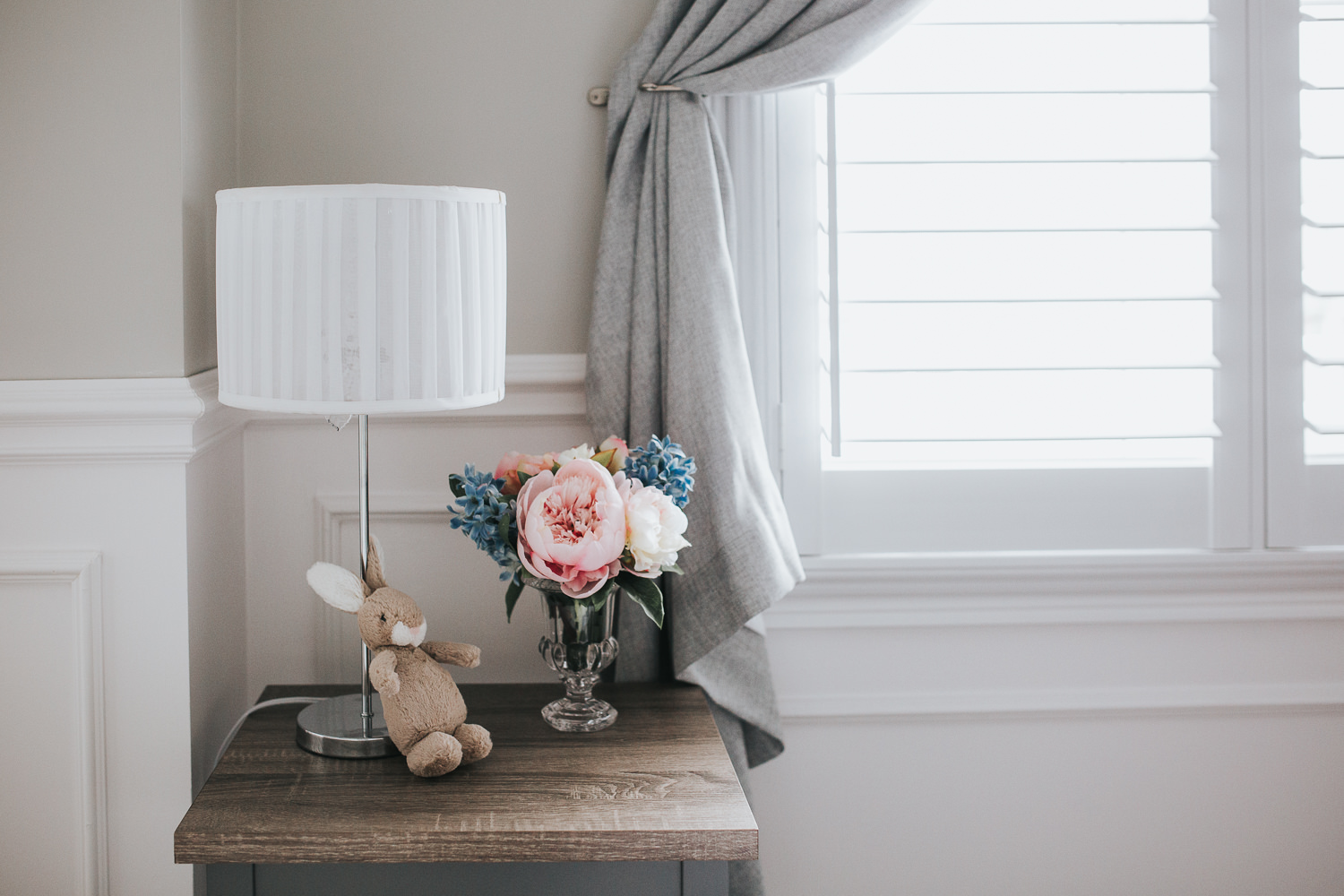 nursery details, side table with pastel peonies and plush bunny - Newmarket Lifestyle Photography