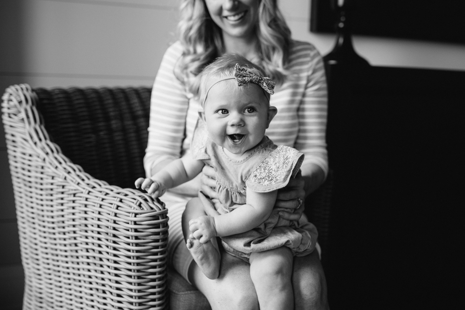 6 month old baby girl in blue dress sitting on mom's lap smiling - Newmarket Lifestyle Family Photography