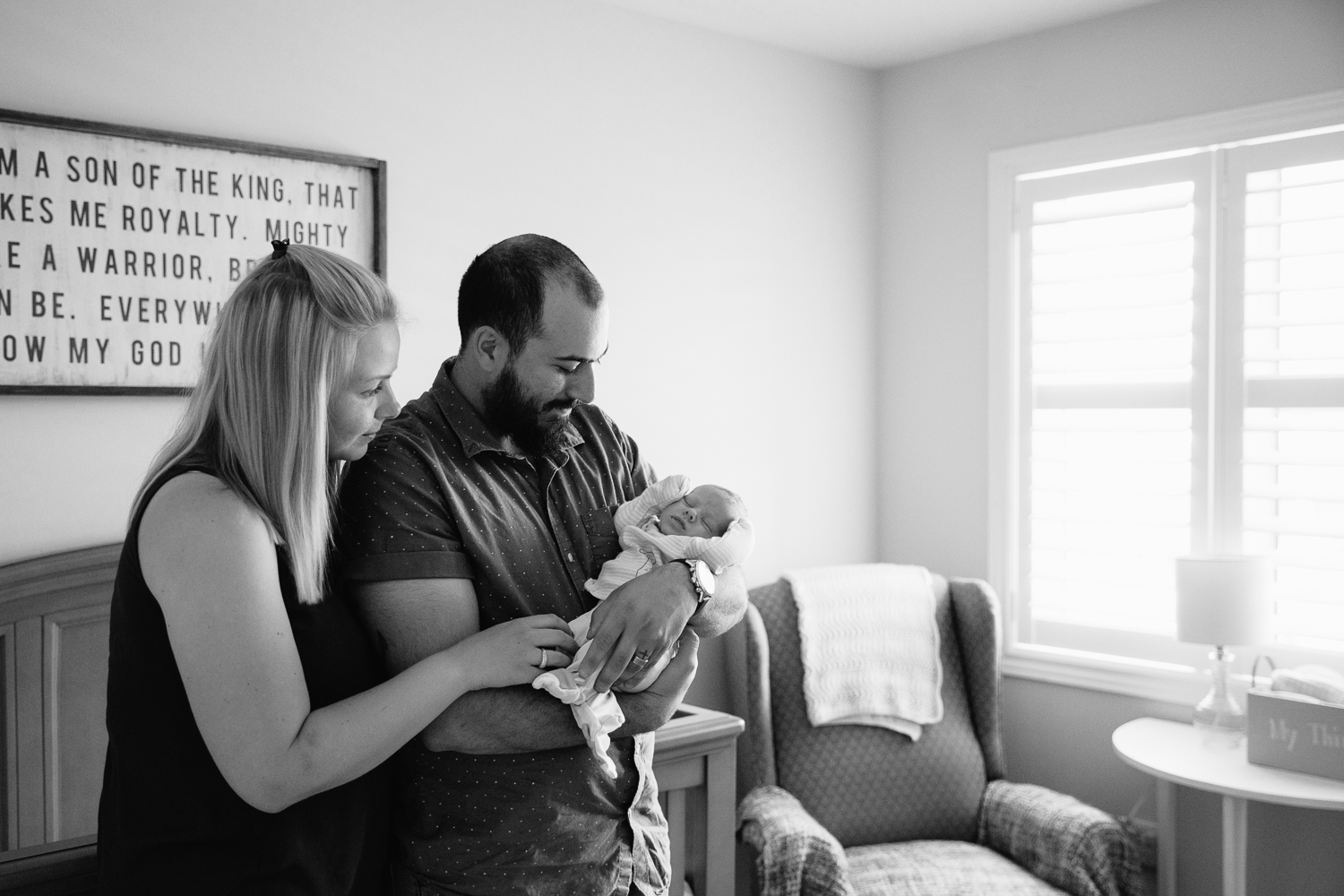first time parents standing in nursery, dad holding sleeping 2 week old baby son - Barrie In-Home Photography