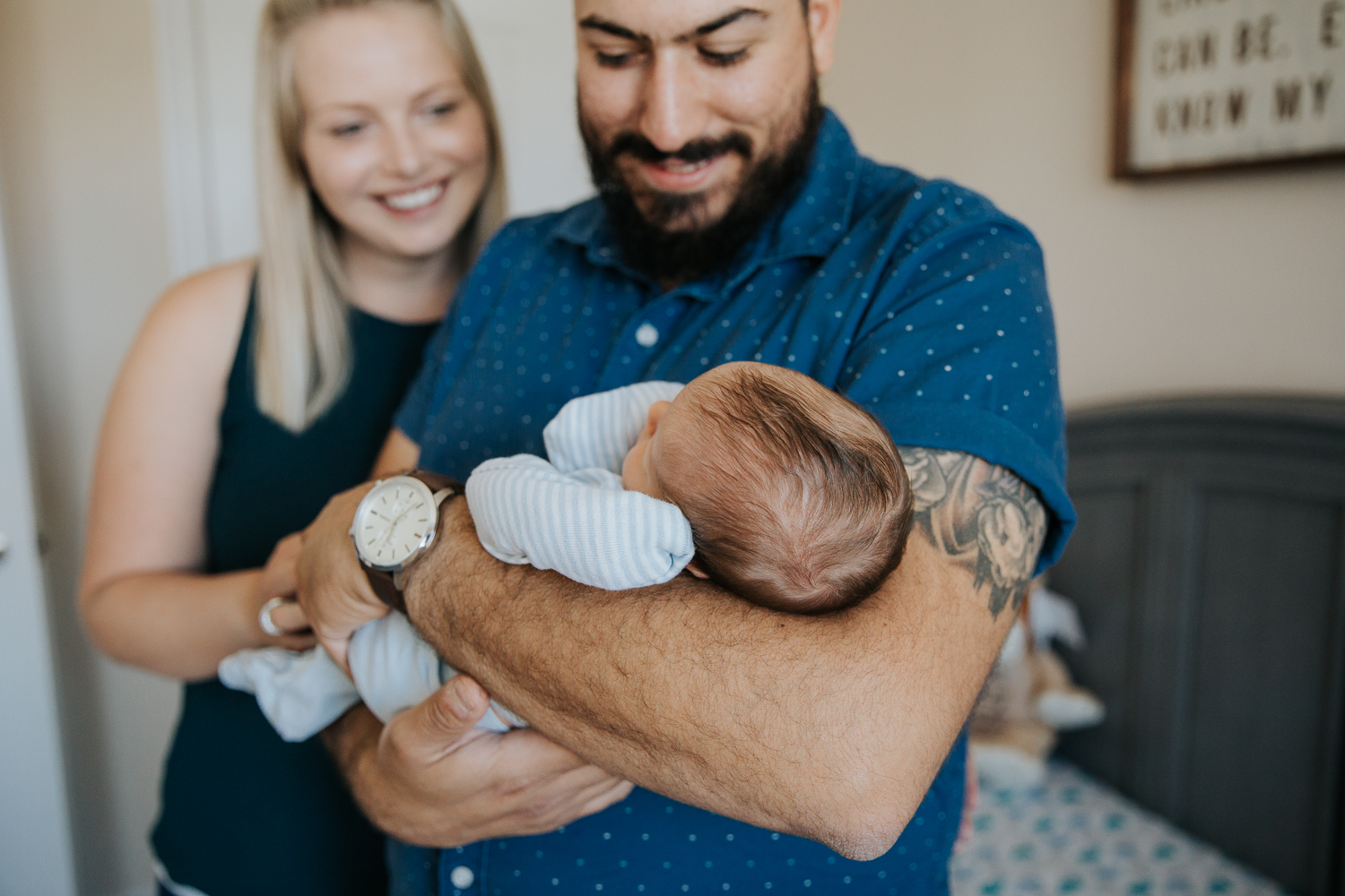 first time parents standing in nursery, dad holding sleeping 2 week old baby boy - Newmarket In-Home Photos