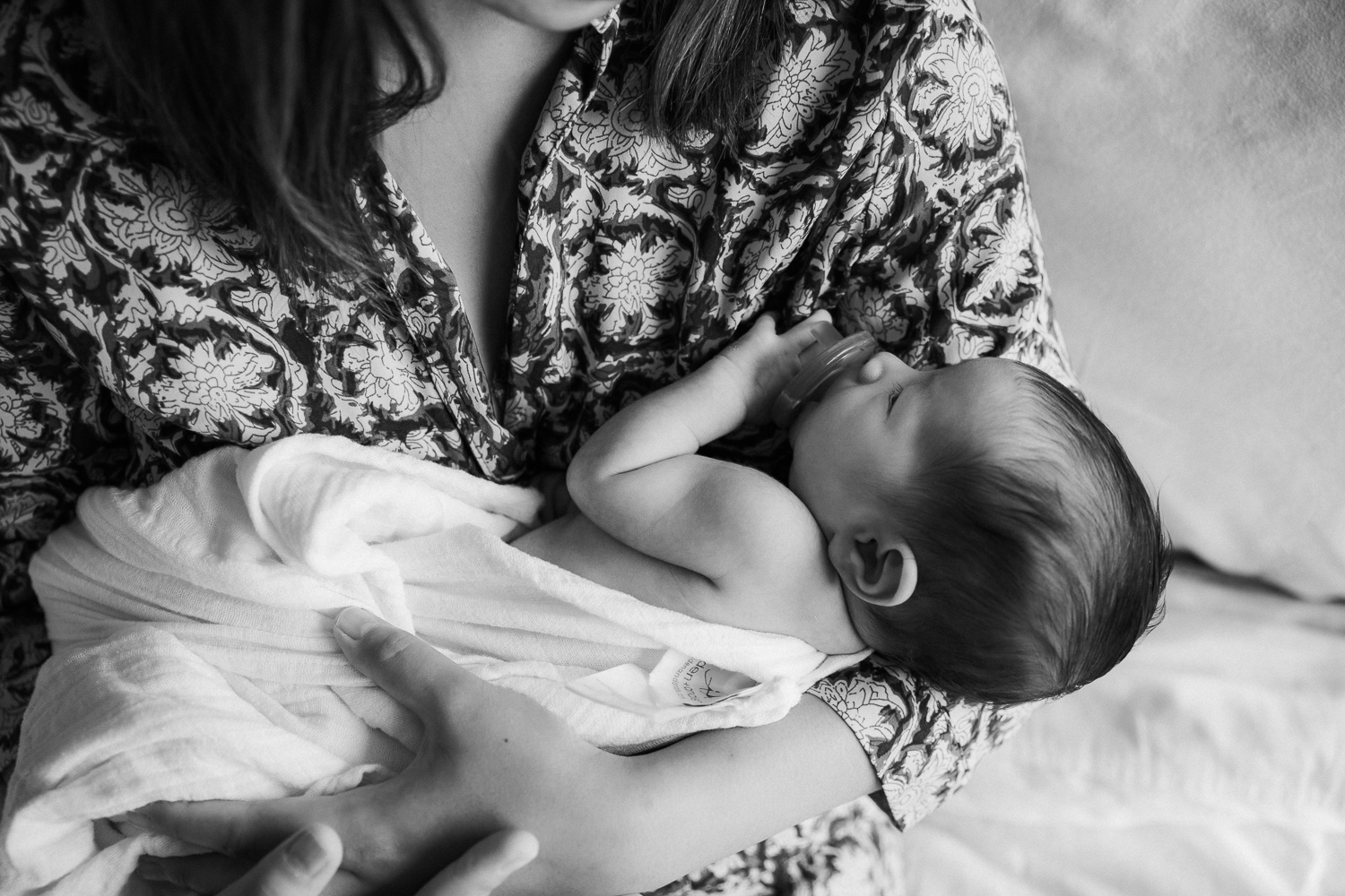 2 week old baby girl sleeping in mother's arms - Stouffville Lifestyle Photography