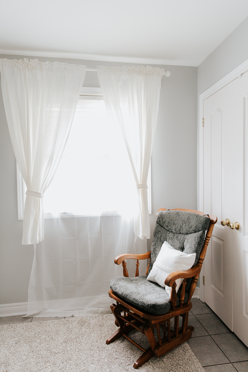 wood glider in nursery corner, grey walls - GTA Lifestyle Photography