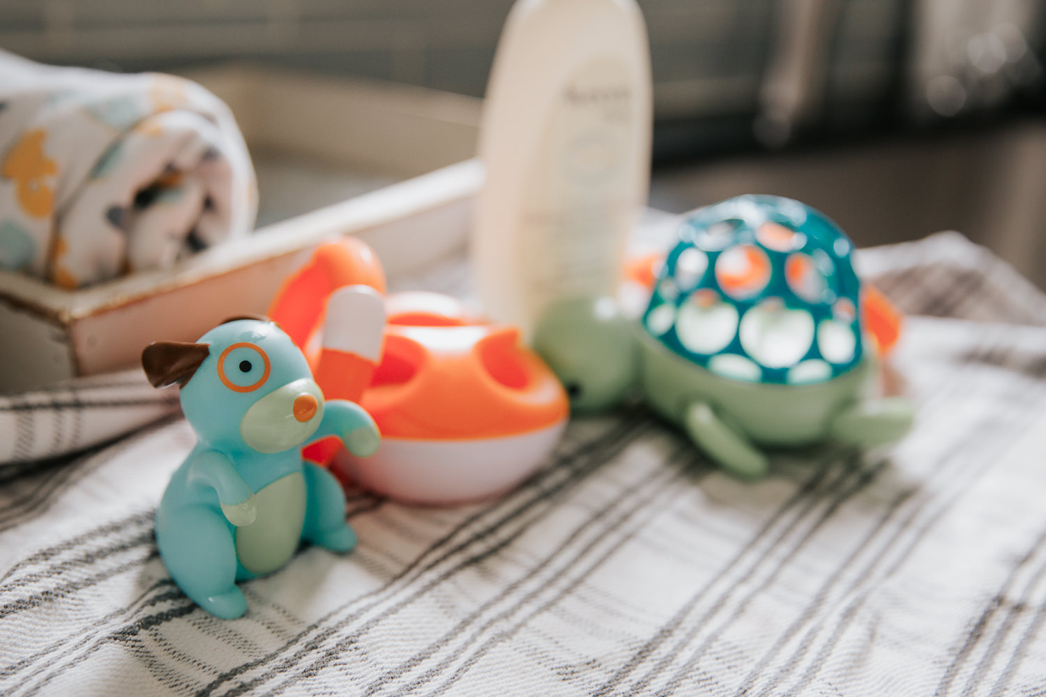 rubber bath toys sitting on towel on kitchen counter - GTA In-Home Photography