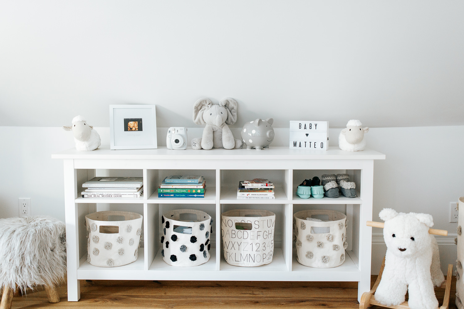 neutral grey and white nursery details, shelf with baskets, books and toys - Stouffville In-HomePhotos