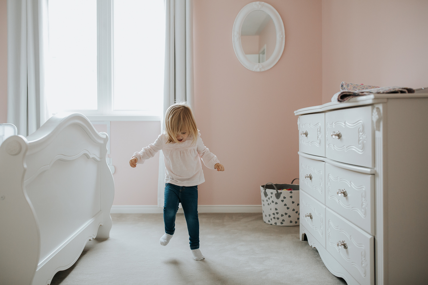 Blonde 2 year old toddler girl dancing in her pink bedroom - Newmarket In-Home Photos