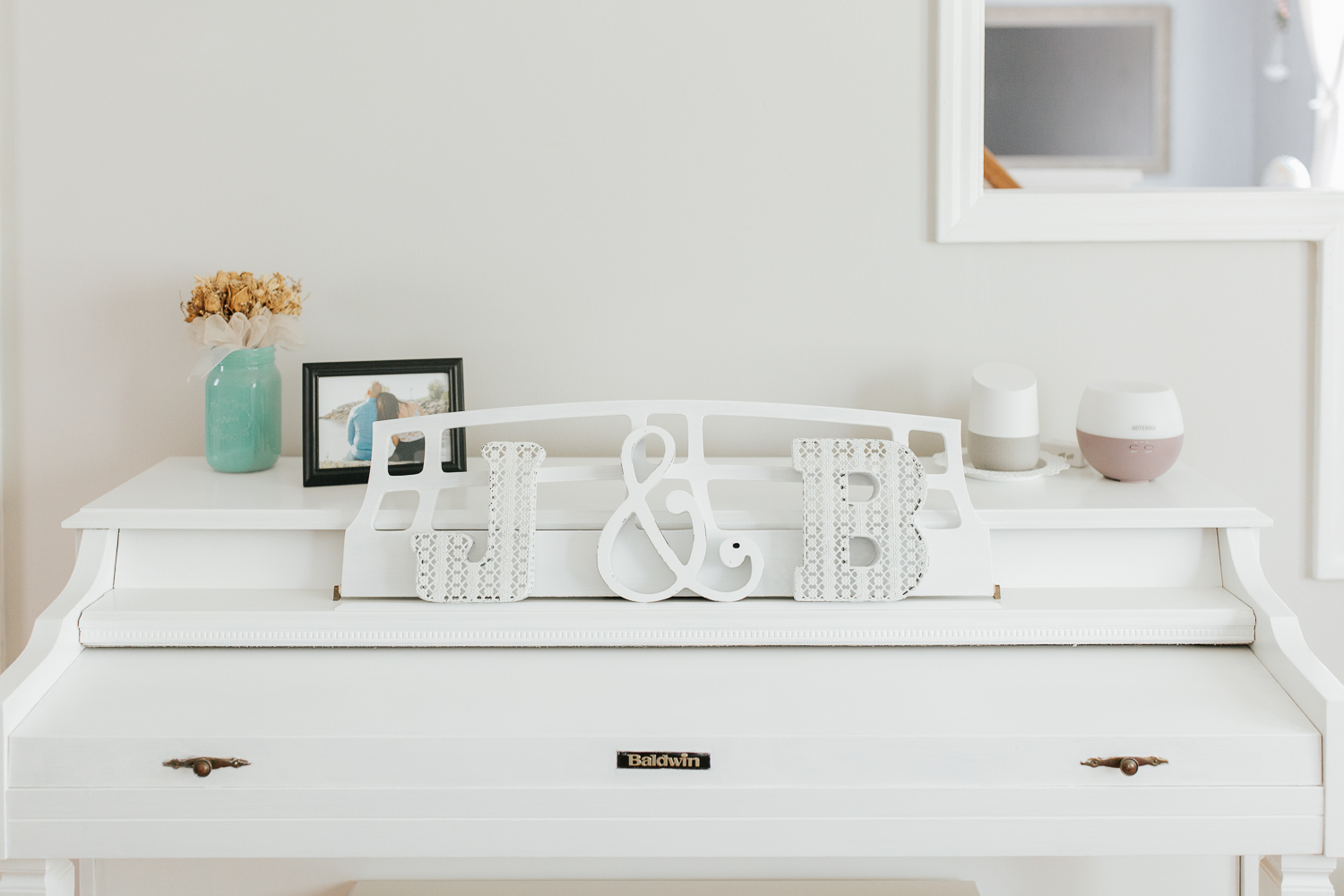 home decor on white piano - Barrie Lifestyle Photos