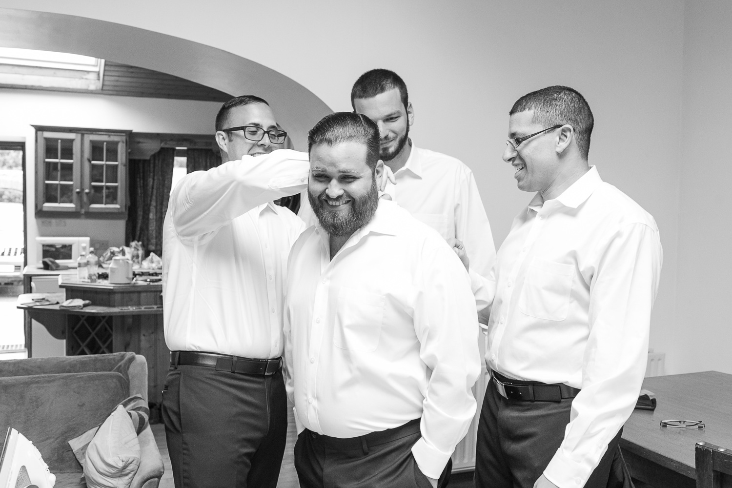 Groom and groomsmen getting ready before the ceremony