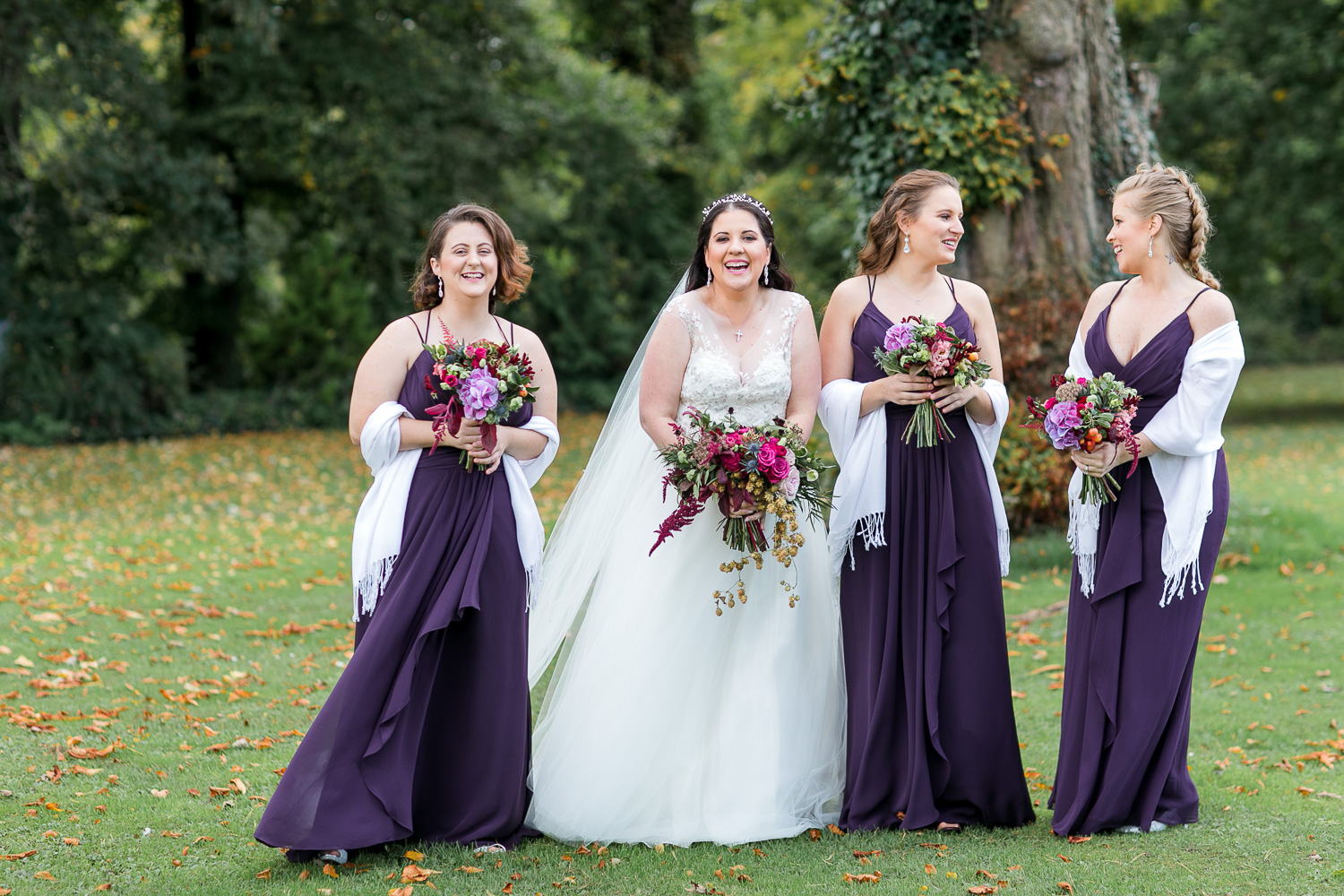 Bride and her bridesmaids on the green with their flowers
