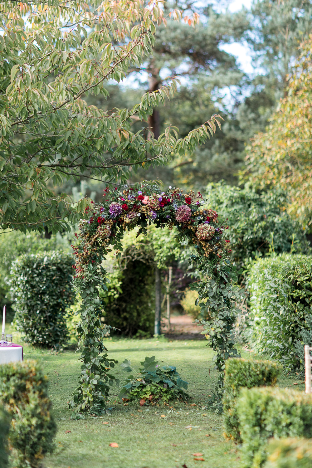 Floral wedding arch for an outside ceremony