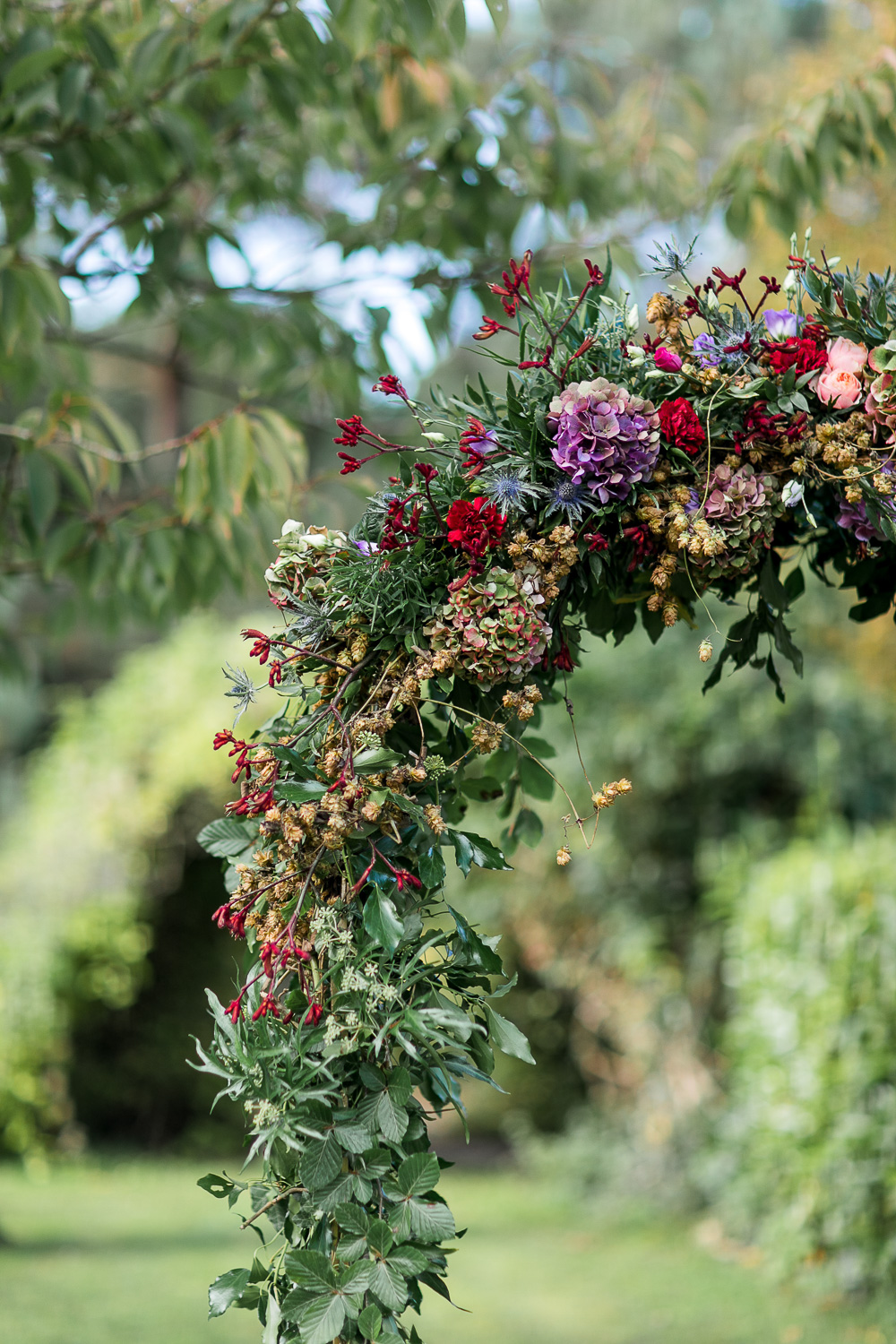 Floral wedding arch details for an outside wedding ceremony