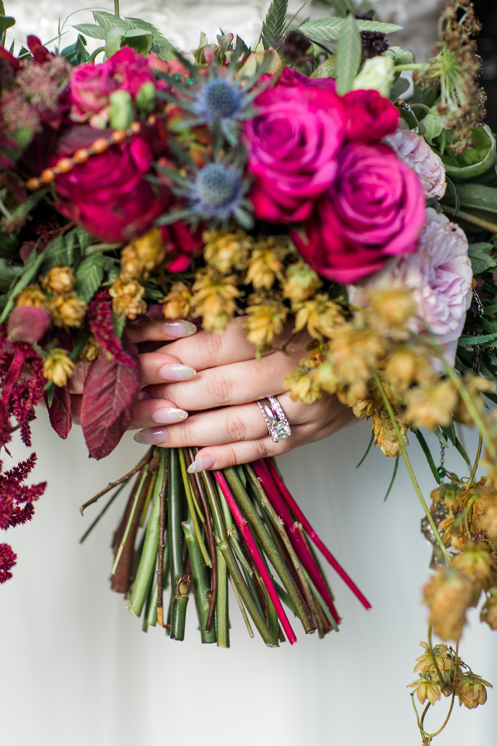 Detail of a bridal bouquet with the wedding rings
