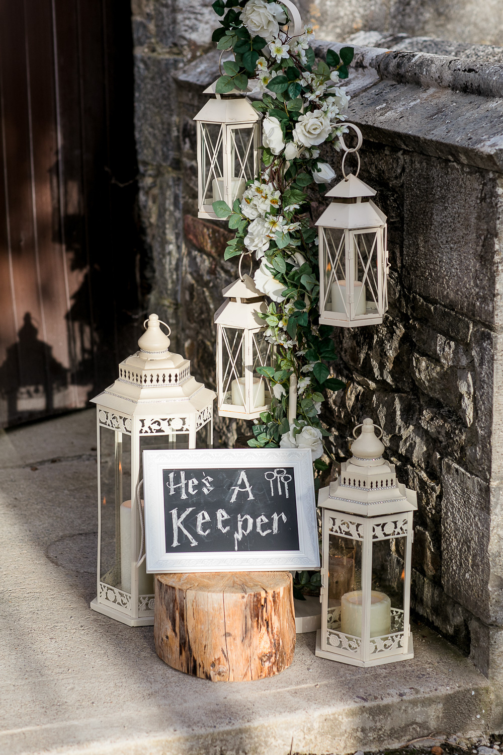 wedding details signs in harry potter font and candle holders on a wooden stand