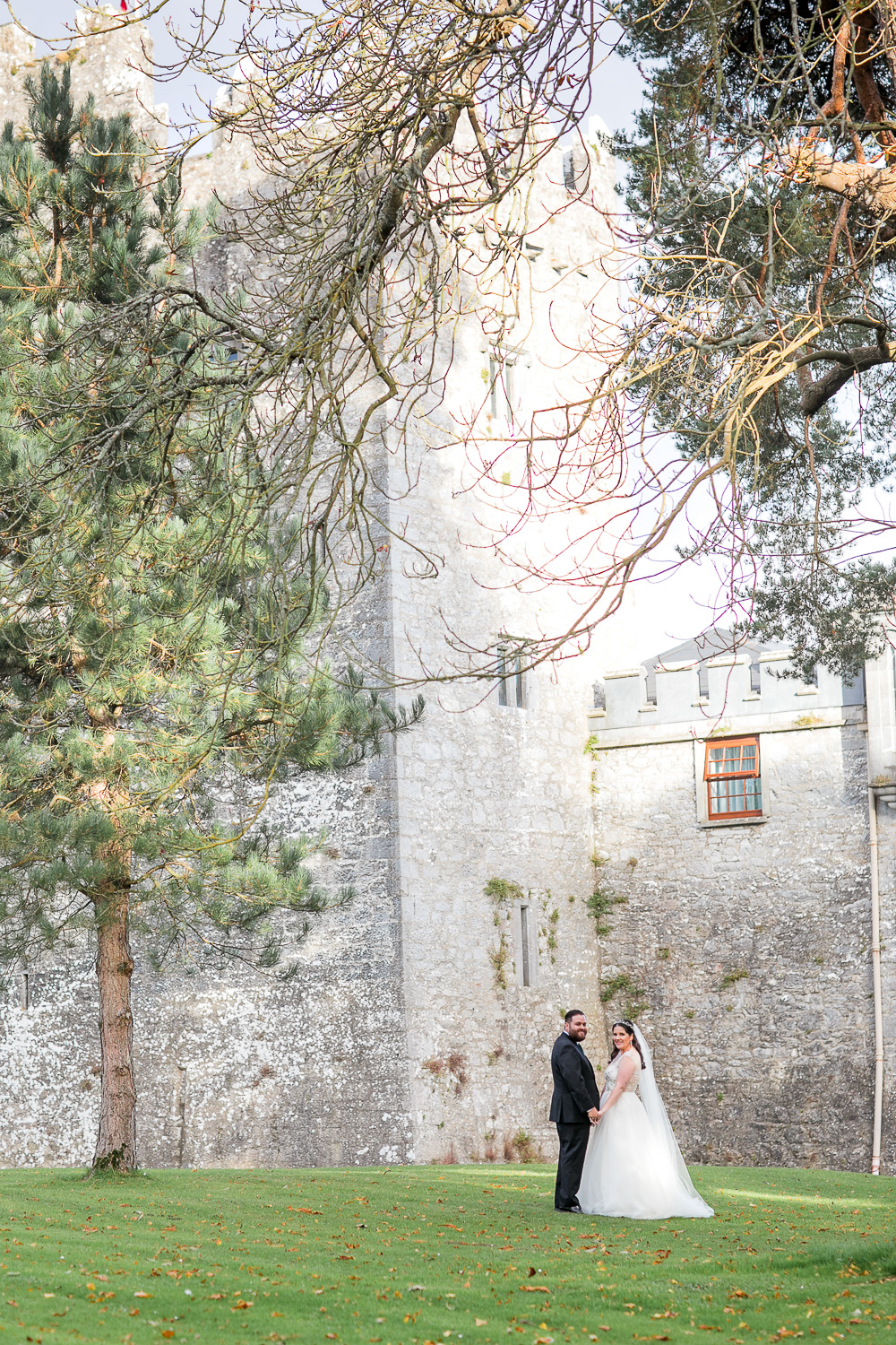 blackwater castle in the background for bride and groom photographs