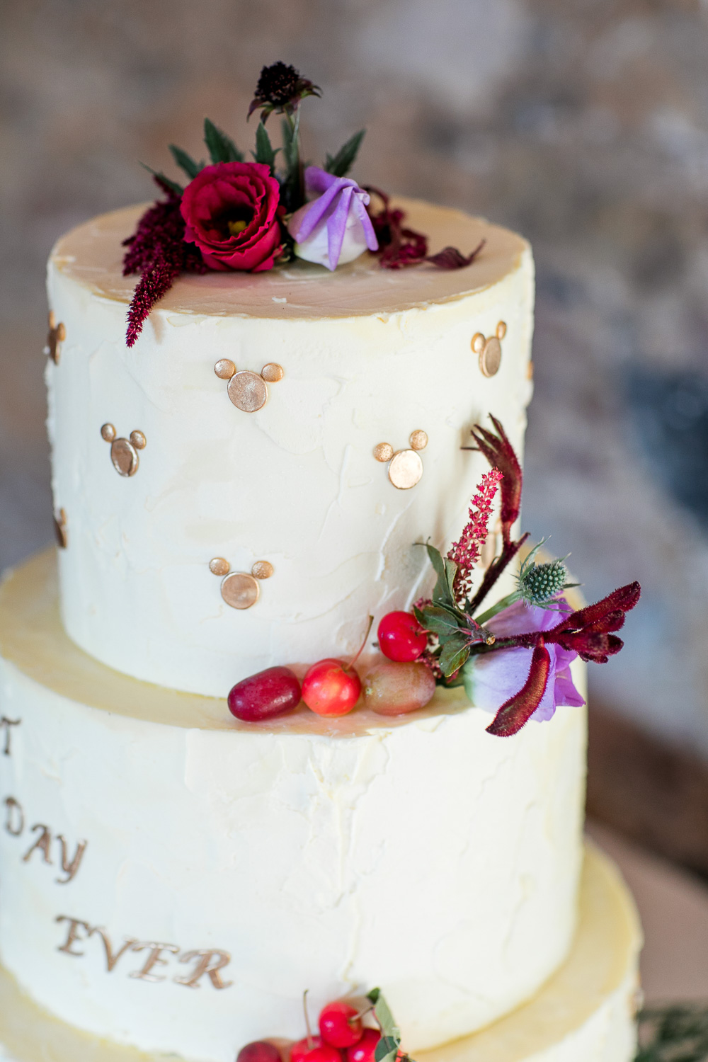 wedding take top decorated with red berries and flowers