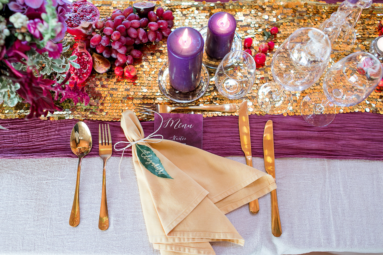 wedding table setting with sequin runner and golden cuttlery