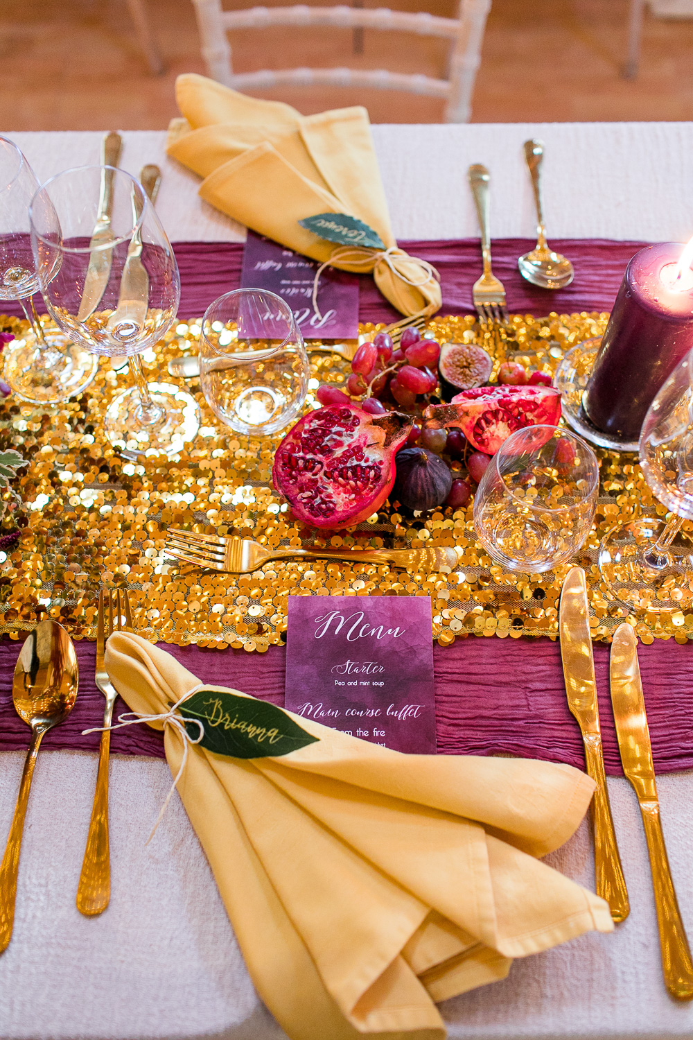 wedding sequin table runner with golden napkins and leaf table setting
