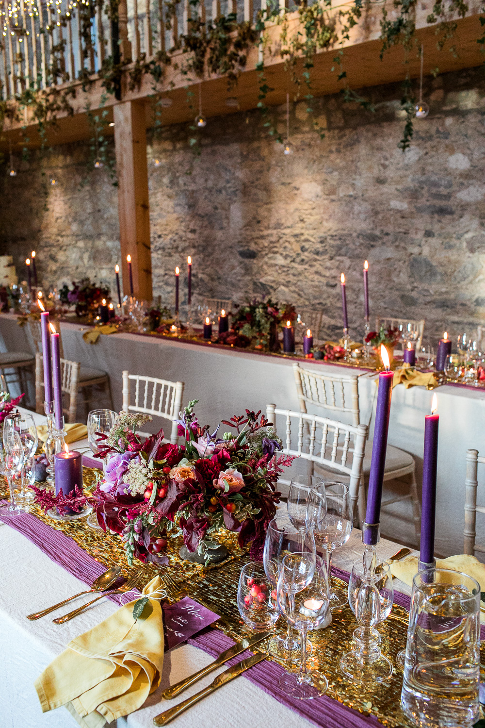purple candles for the wedding table decorations with berries and purple table runner