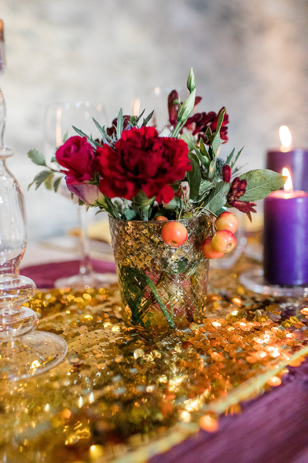sequin wedding table decoration with red flowers and purple candles