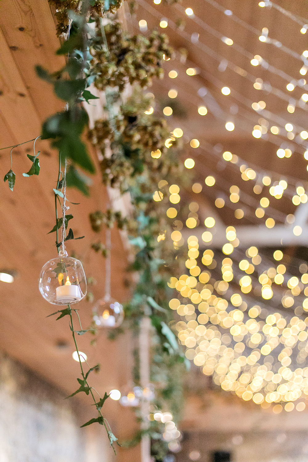 fairy lights with hanging glass candles for wedding function room