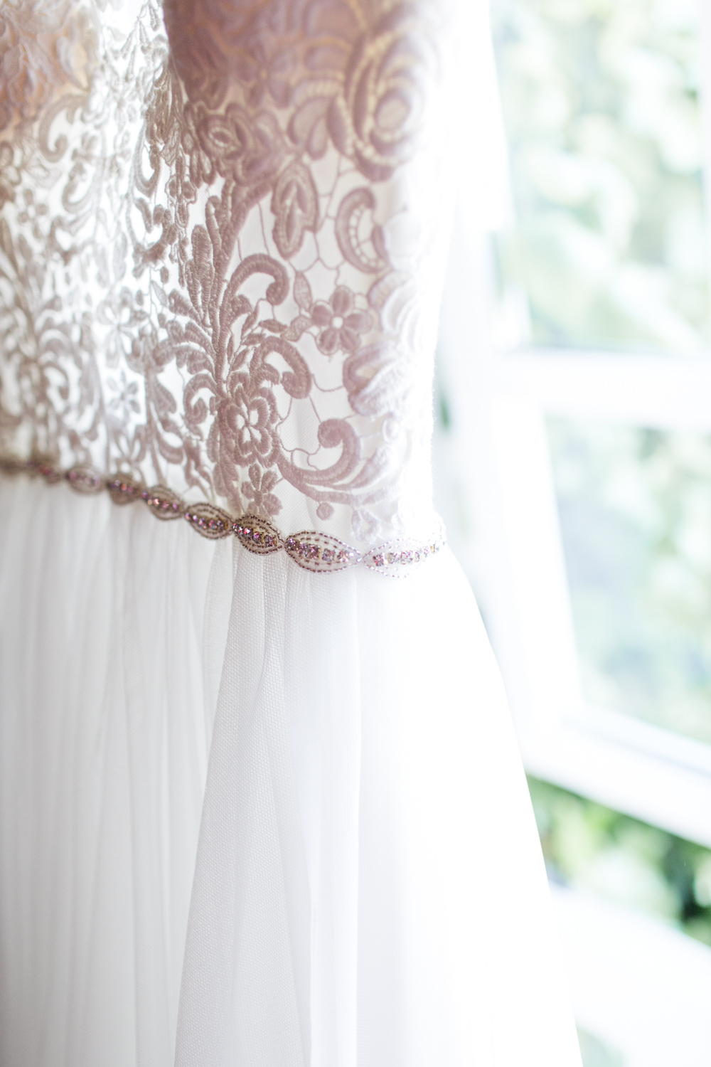 Lace detail of the wedding dress during getting ready time