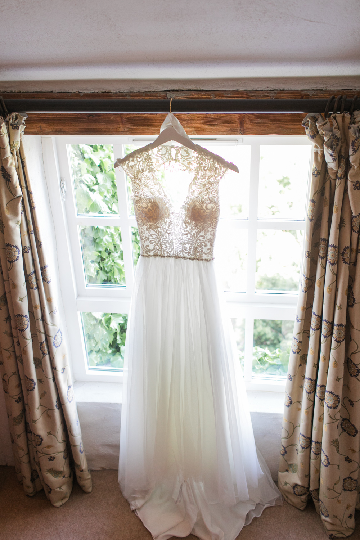 Wedding Dress hanging of the window in Bushmills Hotel in Northern Ireland