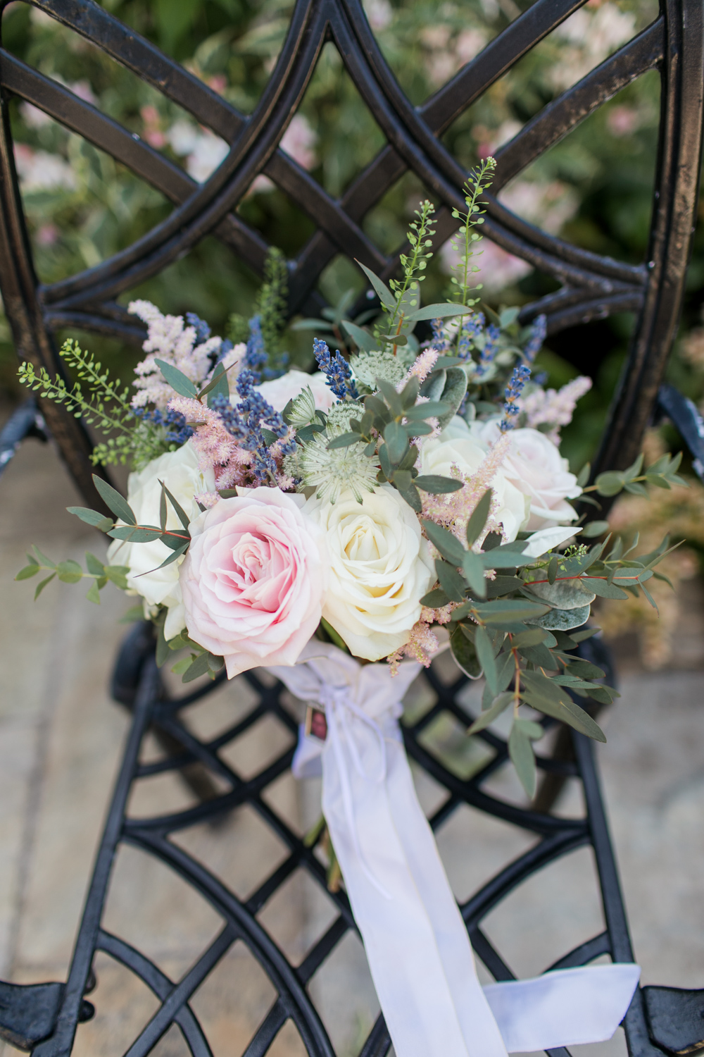 Bridal bouquet with wildflowers pink and white roses in a loose grip
